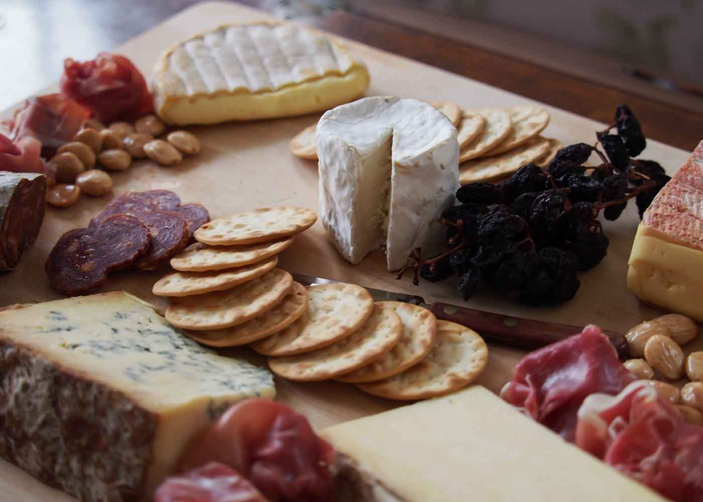 A selection of cheeses, almonds, raisins on the vine and prosciutto from Formaggio Kitchen.