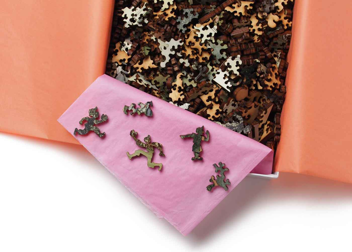 Can you spot some of the novelty pieces in this wooden jigsaw puzzle by Liberty Puzzles?