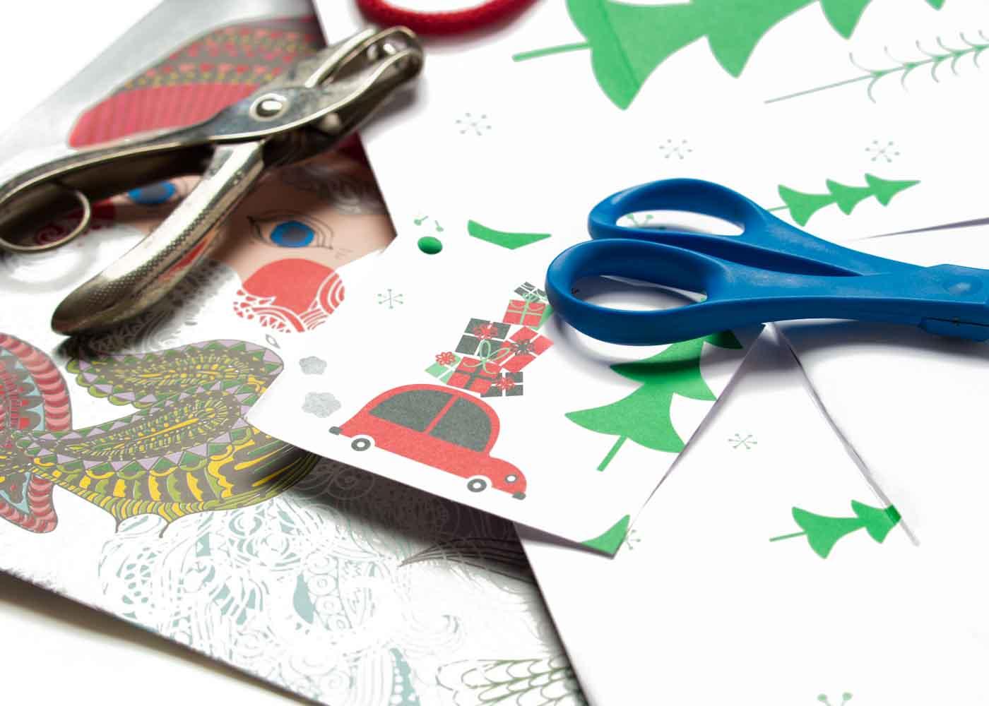 Repurposing holiday shopping bags to make gift tags.
