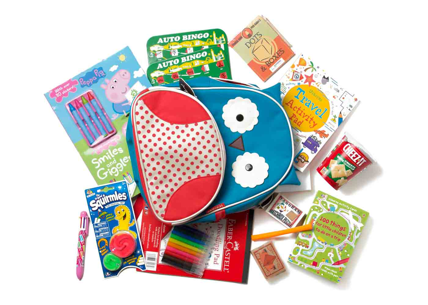 Filling Skip Hop Zoo's Otis Owl backpack with travel-friendly activities for children.