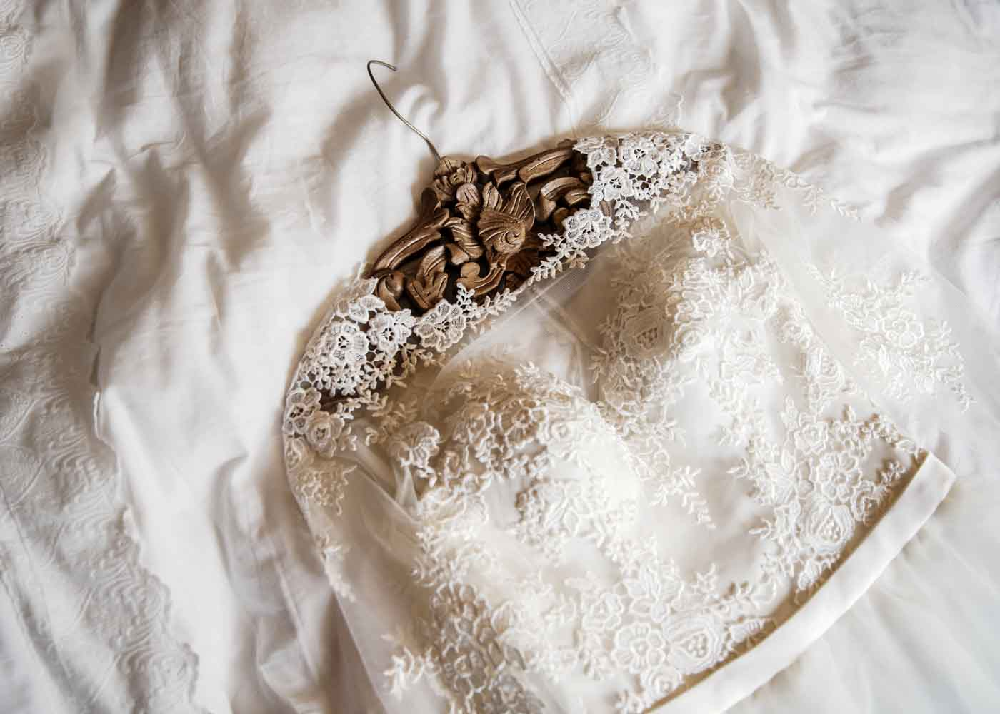 Consider giving a vintage or personalized hanger for the bride's wedding dress.