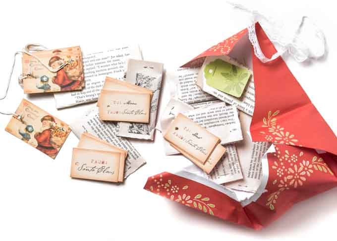 """The lovely, gift tags we purchased from Etsy vendor SweetlyScrappedArt last year, including ones we had customized for """"Mom"""" and """"Dad."""""""