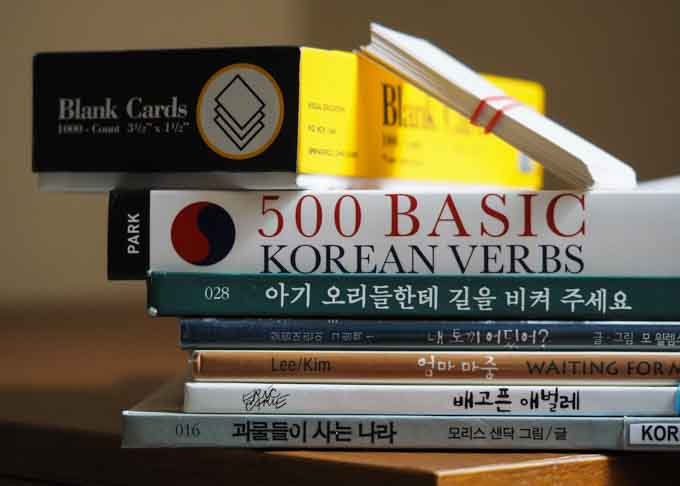 Korean language study aids: flashcards, verb conjugation and children's books.