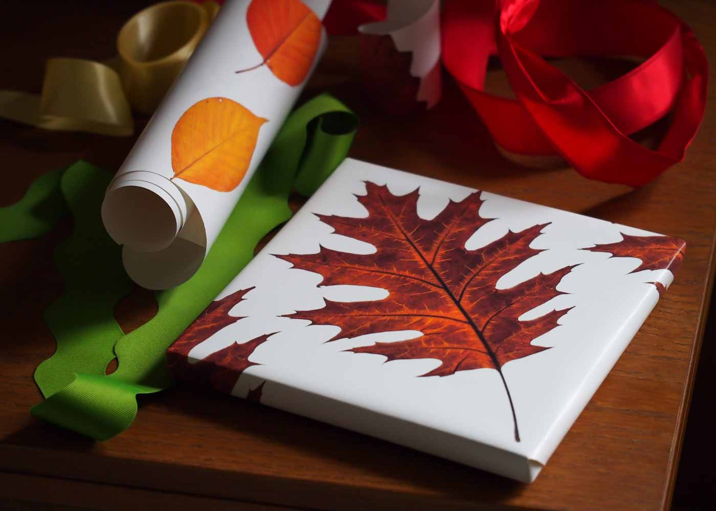 Gift wrapping with our Spoonflower red oak leaf gift wrap.