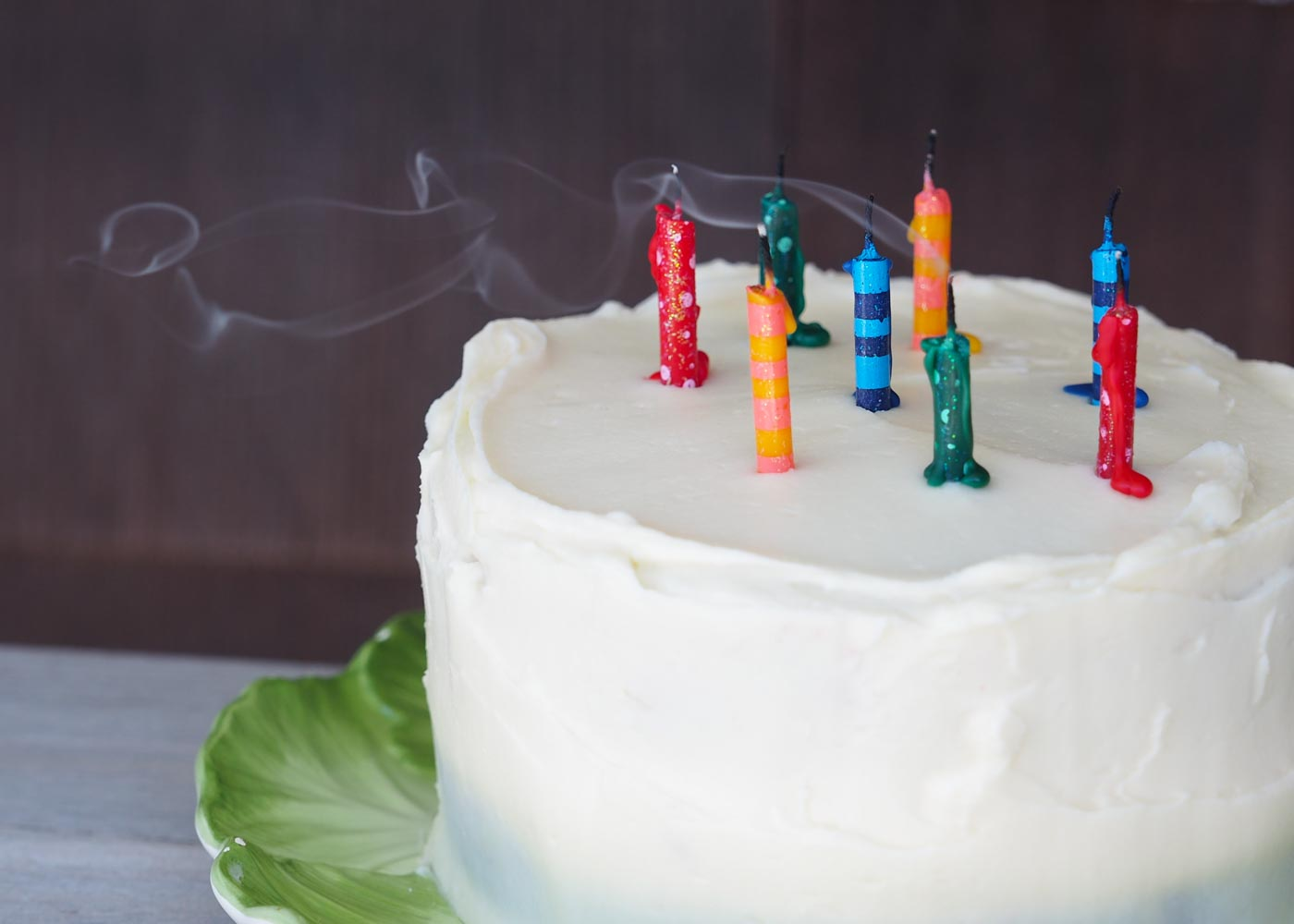Papyrus' striped and spotted glitter candles on a red velvet cake.