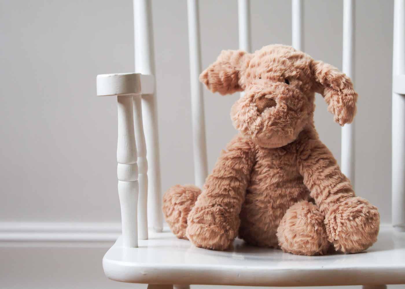 A stuffed puppy by Jellycat.