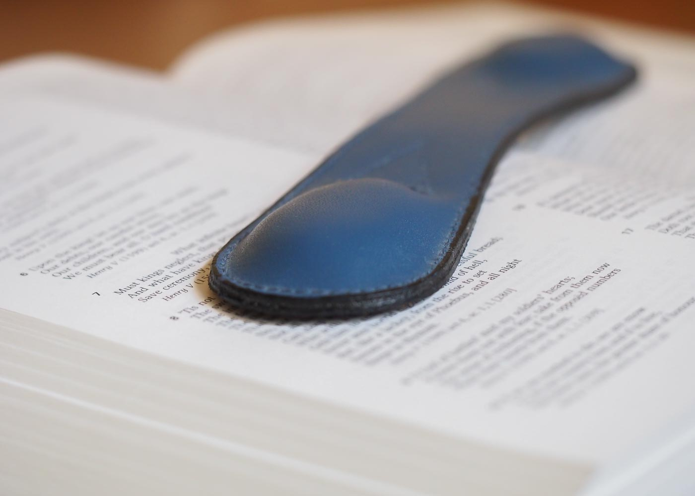A book weight keeps pages from turning of their own accord.