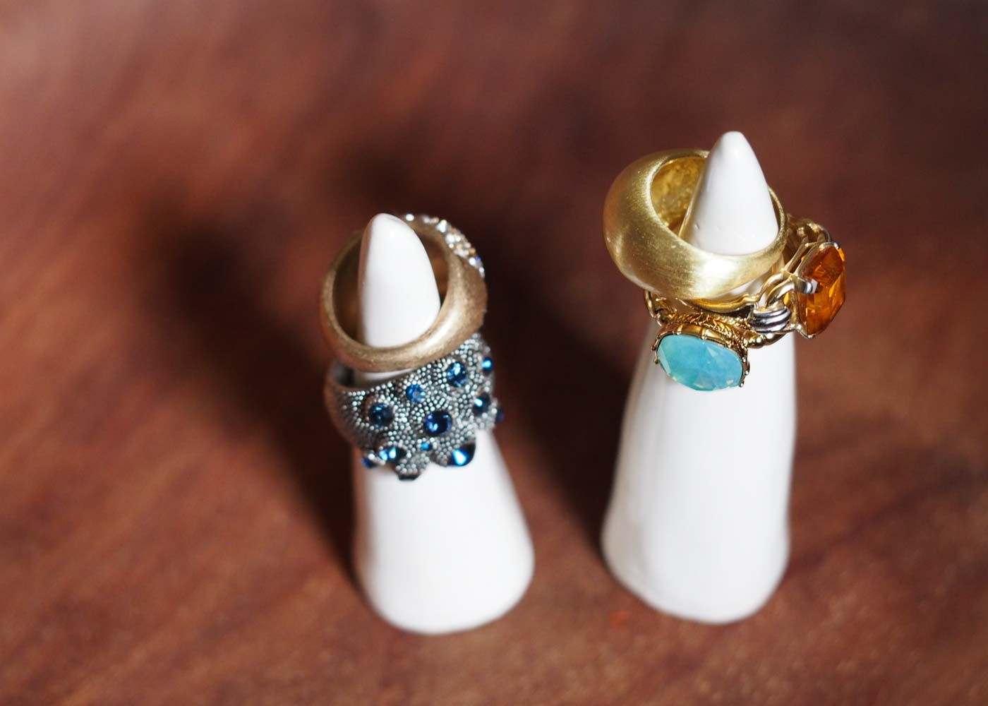 White ceramic ring cones made by Sally, the maker behind Etsy store ZebraWingStudio.